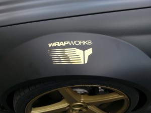 Wrap Works Logo in Gold on Matte Black